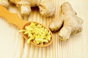 Ginger fresh grated in a wooden spoon